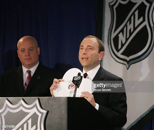 Commissioner Gary Bettman of the National Hockey League presides over the NHL draft lottery and shows the Carolina Hurricanes pick at the Sheraton...