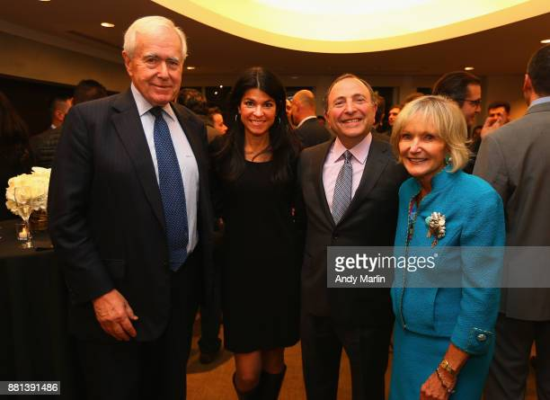 NHL commissioner Gary Bettman poses for a photo with guests during the' History of the NHL The NHL 100 Years' Screening at Paley Center For Media on...