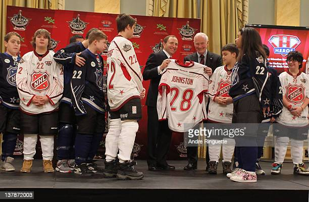 Commissioner Gary Bettman presents Governor General of Canada David Johnston a jersey during the 2012 NHL All-Star Game - H.E.R.O.S. Community...