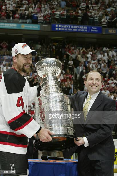 NHL commissioner Gary Bettman presents Scott Stevens of the New Jersey Devils with the Stanley Cup after defeating the Mighty Ducks of Anaheim 30 in...