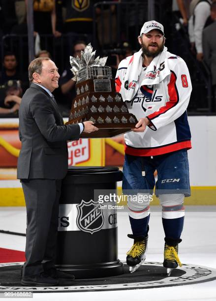 Commissioner Gary Bettman presents the Conn Smythe Trophy to Alex Ovechkin of the Washington Capitals after their victory over the Vegas Golden...