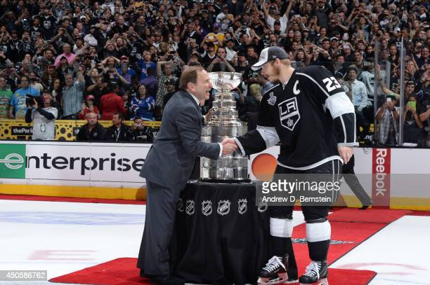 Commissioner Gary Bettman presents the Stanley Cup Trophy to the Dustin Brown of Los Angeles Kings following Game Five of the 2014 NHL Stanley Cup...
