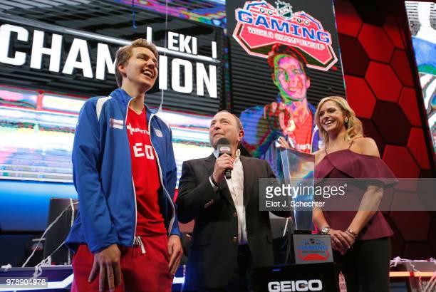 Commissioner Gary Bettman presents the trophy to Erik Tammenpaa aka EKI after EKI won the 2018 NHL Gaming World Championship as sportscaster Kathryn...