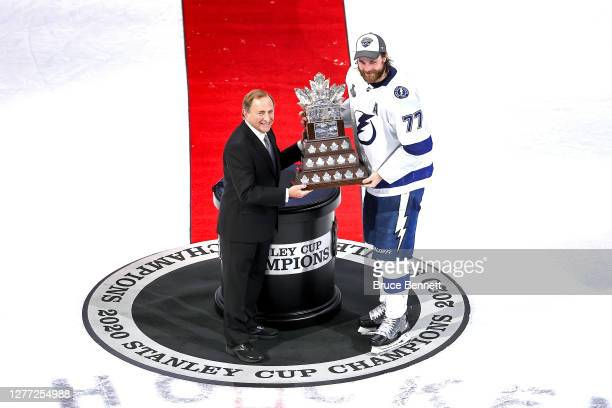 Commissioner Gary Bettman presents Victor Hedman of the Tampa Bay Lightning with the Conn Smythe Trophy for playoff MVP following the Lightning's...