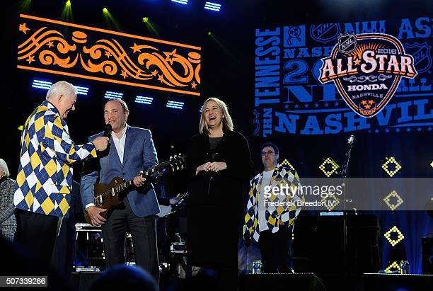 Commissioner Gary Bettman receives a guitar from Nashville Mayor Megan Barry at the Grand Opening Ceremony of the 2016 NHL All Star Festivities at...