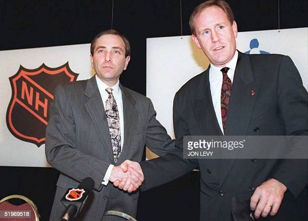 NHL commissioner Gary Bettman shakes hands with Bob Goodenow the executive director of the NHL Players Association after announcing an agreement had...