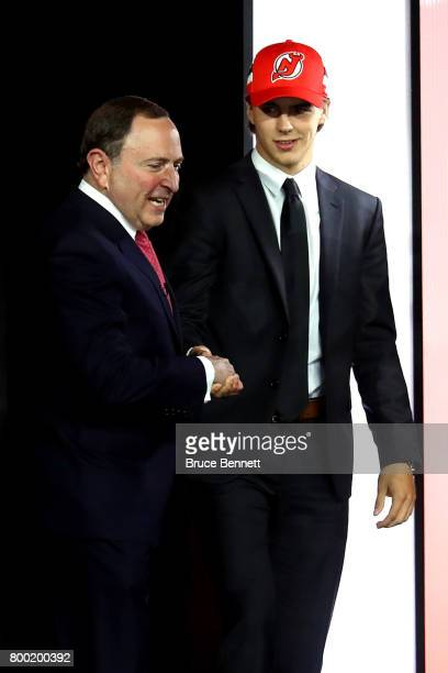 Commissioner Gary Bettman shakes hands with Nico Hischier after being selected first overall by the New Jersey Devils during the 2017 NHL Draft at...