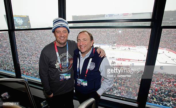 Commissioner Gary Bettman smiles for a photo alongside actor Matthew Perry during the 2014 Bridgestone NHL Winter Classic between the Detroit Red...