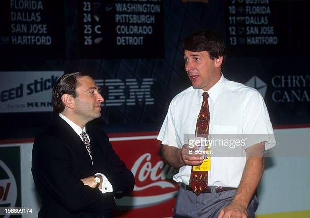 Commissioner Gary Bettman speaks with general manager Mike Milbury of the New York Islanders before the 1995 NHL Draft on July 8 1995 at the Edmonton...