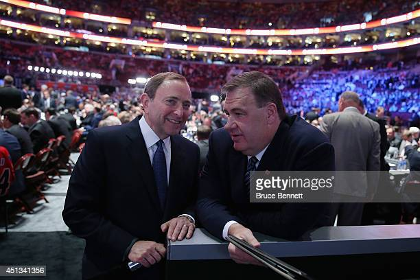 Commissioner Gary Bettman speaks with Jim Benning General Manager of the Vancouver Canucks before the first round of the 2014 NHL Draft at the Wells...
