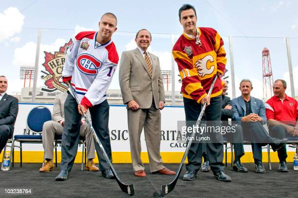 Commissioner Gary Bettman stands for a photo with Josh Gorges of the Montreal Canadiens and Steve Staios of the Calgary Flames at the NHL Heritage...