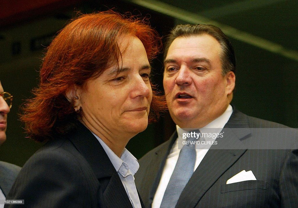 EU Commissioner in charge of Transports and Energy Spanish Loyola de Palacio (L) chats with Luxembourg Transport Minister Henri Grethen (R) prior the opening of the Energy Council at the EU Headquarters in Brussels 25 November 2002.