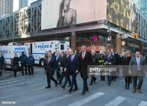 Commissioner James O'Neill NY Governor Andrew Cuomo and NYC Mayor Bill de Blasio arrive for a press conference as police respond to a reported...