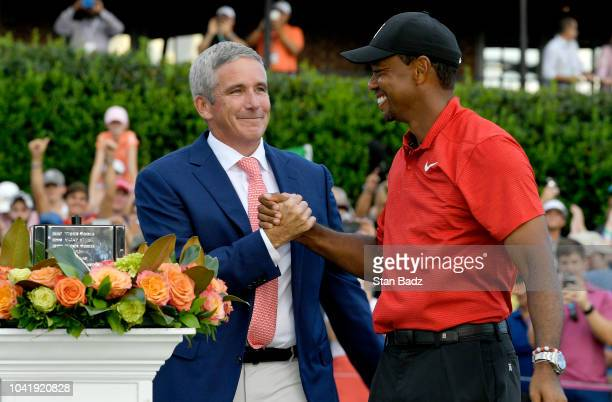 Commissioner Jay Monahan congratulates Tiger Woods after the final round of the TOUR Championship at East Lake Golf Club on September 23 in Atlanta...