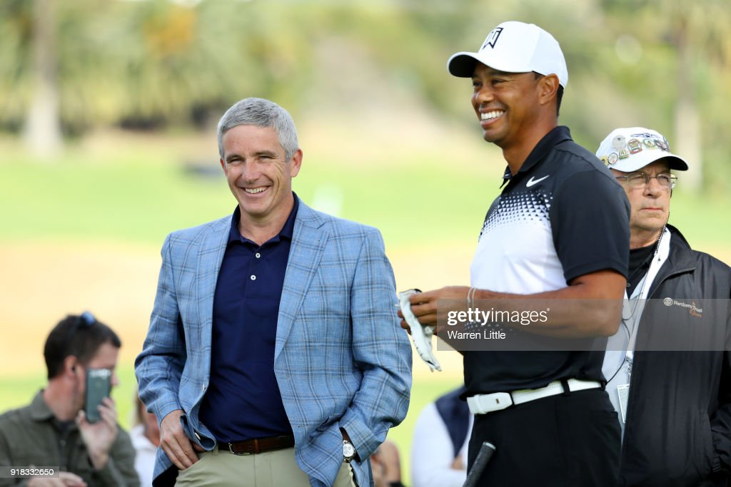 Commissioner Jay Monahan (L) meets with Tiger Woods during the Pro-Am of the Genesis Open at the Riviera Country Club on February 14, 2018 in Pacific Palisades, California.
