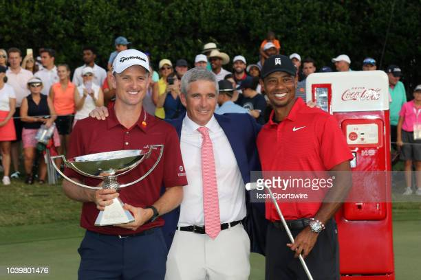 Commissioner Jay Monahan poses with Justin Rose and Tiger Woods after the final round of the Tour Championship on September 23 at East Lake Golf Club...