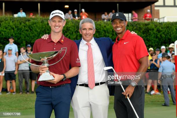 Commissioner Jay Monahan with Justin Rose of England FedExCup winner and Tiger Woods winner of the TOUR Championship after the final round of the...