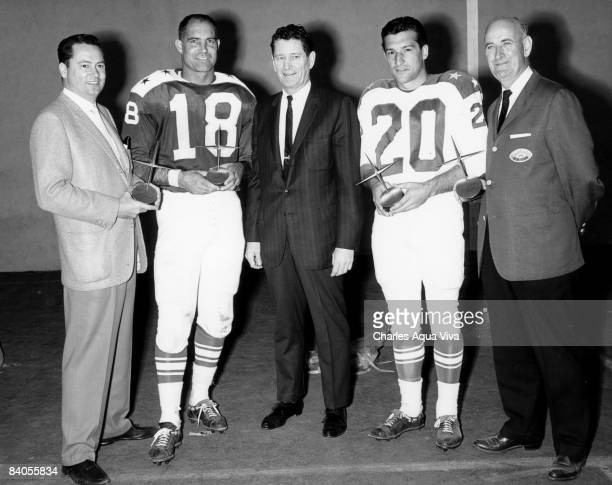 AFL Commissioner Joe Foss awards Barron Hilton president of the San Diego Chargers Tobin Rote of the Chargers as Western Division Player of the Year...