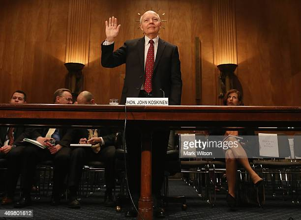 Commissioner John Koskinen is sworn in before testifying before a Senate Homeland Security and Governmental Affairs Committee on Capitol Hill April...