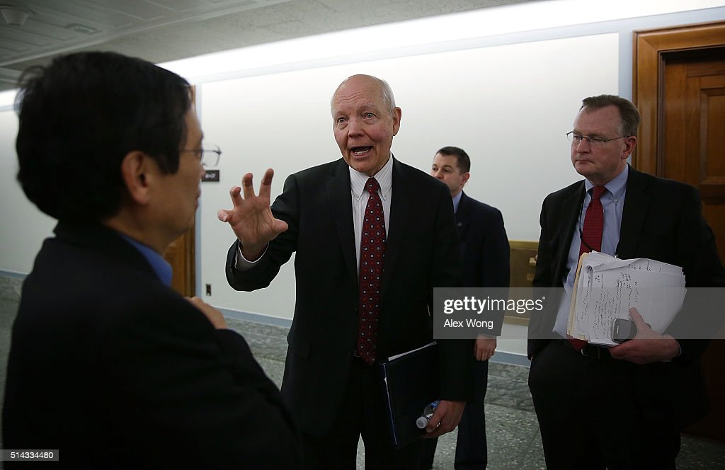 Commissioner John Koskinen talks to a reporter after a hearing before the Financial Services and General Government Subcommittee of the Senate Appropriations Committee March 8, 2016 on Capitol Hill in Washington, DC. The subcommittee held a hearing to examine the FY2017 budget for the Treasury Department.