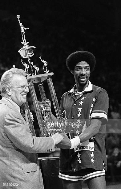 Commissioner Larry O'Brien presents the Most Valuable Player award to Julius Erving of the Philadelphia 76ers in the NBA all Star game in Milwaukee,...