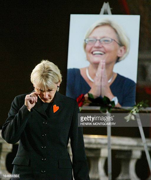 EU commissioner Margot Wallstrom a close personal friend of Swedish Foreign Minister Anna Lindh wipes her eye during the memorial service in the...