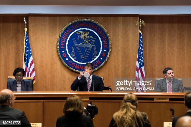 Commissioner Mignon Clyburn FCC Chairman Ajit Pai and commissioner Michael O'Rielly listen during a hearing at the Federal Communications Commission...