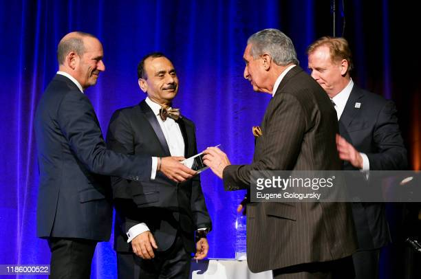 Commissioner MLS Don Garber Honoree Arthur M Blank Chairman Dept of Urology Ashutosh K Tewari and Commissioner NFL Roger Goodell pose onstage during...