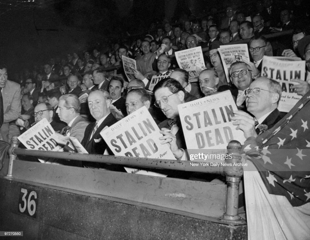 Commissioner Monaghan, News lawyer J. Howard Carter, District Attorney D. A. Hogan, Mayor Impellitteri, Ivan Annenberg and News lawyer Stuart Updike (l. to r.) reading the News coverage of Stalin's death. They are attending the Golden Gloves in Madison Square Garden.