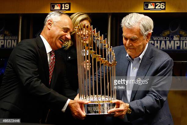 Commissioner of Baseball Rob Manfred presents Kansas City Royals owner David D Glass with the Commissioner's Trophy after the Kansas City Royals...