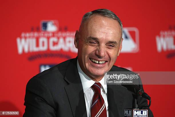 Commissioner of Baseball Rob Manfred reacts during a press conference prior to the American League Wild Card game between the Toronto Blue Jays and...