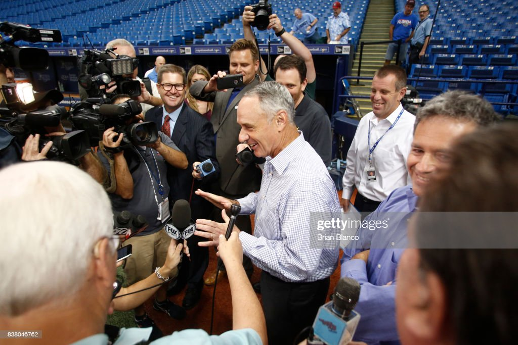 Commissioner of Baseball Rob Manfred speaks with reporters before the start of a game between the Tampa Bay Rays and the Toronto Blue Jays on August 23, 2017 at Tropicana Field in St. Petersburg, Florida.