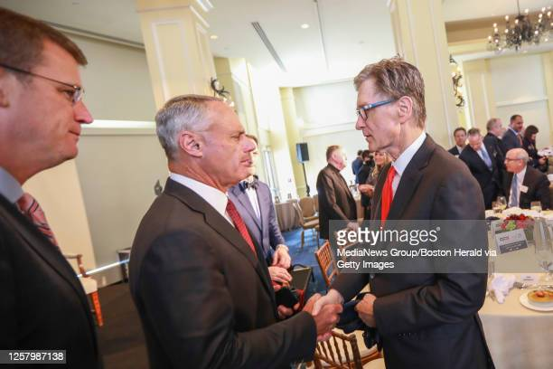 March 6, 2019: Commissioner of Baseball Robert D. Manfred Jr. Center, greets Boston Red Sox Owner John Henry during the Boston College Chief...
