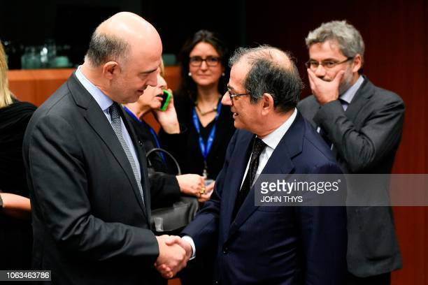 EU Commissioner of Economic and Financial Affairs Taxation and Customs Pierre Moscovici talks with Italian Minister of Economy and Finance Giovanni...