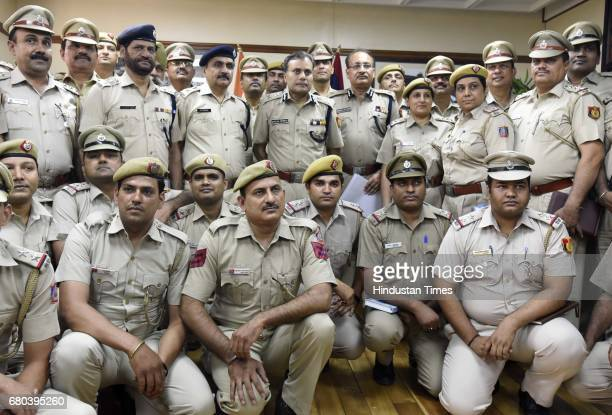 Commissioner of Police Delhi Amulya Patnaik and Special Commissioner of Police Delhi Depender Pathak with Senior Police team members during the team...