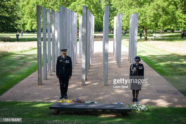 Commissioner of the City of London Police Ian Dyson and Commissioner of the Metropolitan Police Cressida Dick lay wreaths at the 7/7 memorial in Hyde...