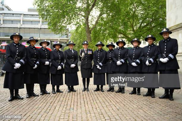 Commissioner of the Metropolitan Police Service Cressida Dick poses with serving police officers in the original female police uniform at Westminster...