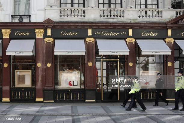 Commissioner of the Metropolitan Police Service Cressida Dick walks past a closed Cartier store as she takes part in a police patrol on New Bond...