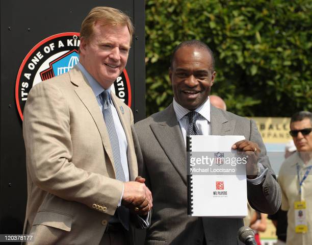 Commissioner of the National Football League Roger Goodell and Director of the National Football League Players' Association DeMaurice Smith pose...