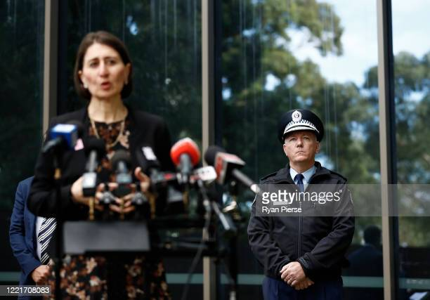 Commissioner of the New South Wales Police Force Mick Fuller look on as NSW Premier Gladys Berejiklian speaks during a media briefing on April 29...