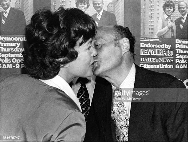 Commissioner of the New York City Department of Consumer Affairs Bess Myerson kisses policitian Ed Koch at a event for the latter's mayoral campaign...