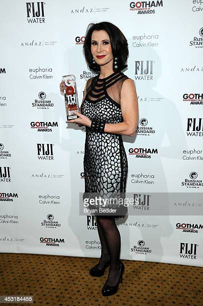 Commissioner of the New York City Mayor's Office of Media and Entertainment Katherine Oliver poses with an award at the 2013 Gotham Independent Film...