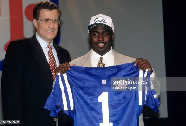 Commissioner Paul Tagliabue stands with Marshall Faulk the number 1 draft pick of the Indianapolis Colts in the 1994 NFL draft April 24 1994 at the...