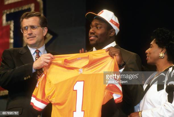 Commissioner Paul Tagliabue stands with Warren Sapp the number 1 draft pick of the Tampa Bay Buccaneers in the 1995 NFL draft April 22 1995 at...