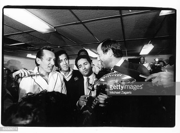 NFL commissioner Pete Rozelle presents the Vince Lombardi Trophy to Oakland Raiders owner Al Davis as head coach Tom Flores and NBC reporter Bryant...