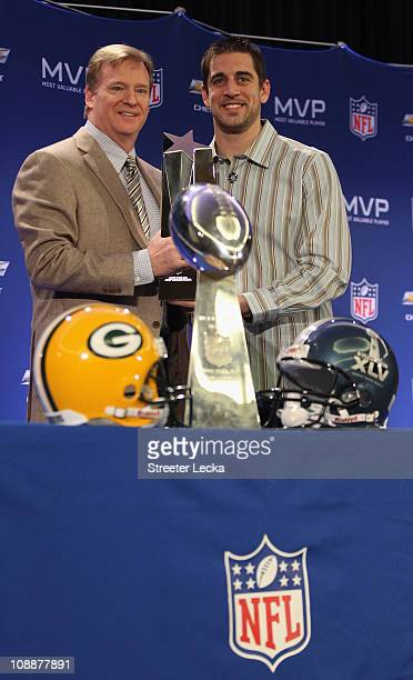 Commissioner Roger Goodell and Green Bay Packers quarterback Aaron Rodgers pose with the MVP trophy after speaking to the media during a press...