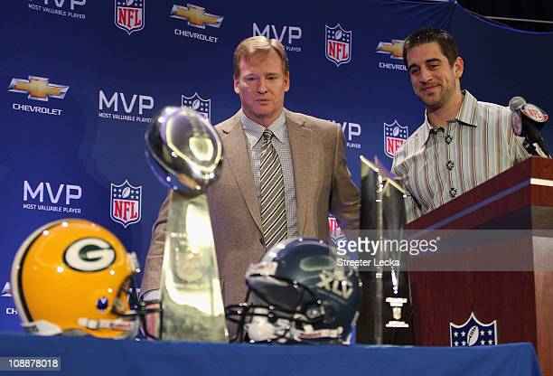 Commissioner Roger Goodell and Green Bay Packers quarterback Aaron Rodgers look on after speaking to the media during a press conference at Super...