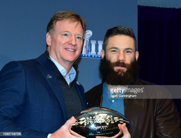 Commissioner Roger Goodell awards the Super Bowl MVP to Julian Edelman of the New England Patriots at the Georgia World Congress Center on February 4...