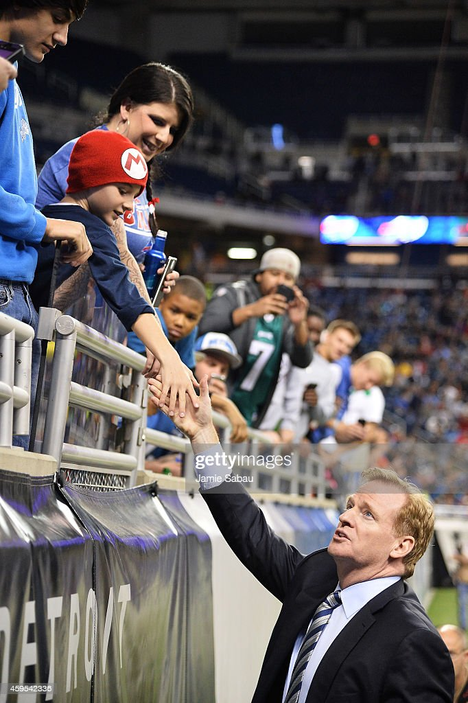Commissioner Roger Goodell greets fans on the field before the game between the Buffalo Bills and the New York Jets at Ford Field on November 24, 2014 in Detroit, Michigan.