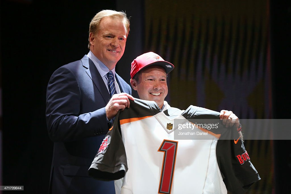 Commissioner Roger Goodell holds up a jersey after the Tampa Bay Buccaneers chose Jameis Winston of the Florida State Seminoles #1 overall during the first round of the 2015 NFL Draft at the Auditorium Theatre of Roosevelt University on April 30, 2015 in Chicago, Illinois.
